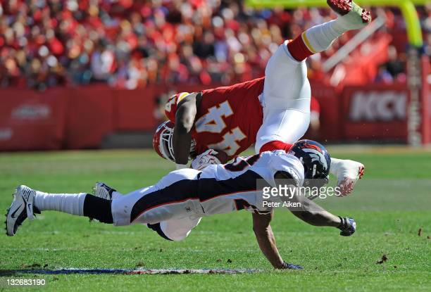 Strong safety Brian Dawkins of the Denver Broncos upends running back Le'Ron McClain of the Kansas City Chiefs on November 13 2011 during the first...