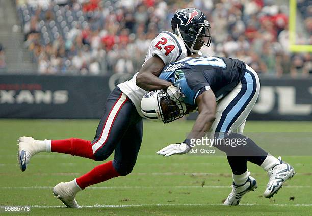 Strong safety CC Brown of the Houston Texans tackles tight end Ben Troupe of the Tennessee Titans at Reliant Stadium on October 9 2005 in Houston...