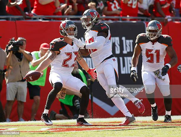 Strong safety Chris Conte of the Tampa Bay Buccaneers celebrates with teammate middle linebacker Kwon Alexander after returning an interception 20...