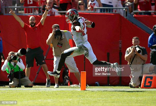 Strong safety Chris Conte of the Tampa Bay Buccaneers returns an interception for a touchdown during the first quarter of an NFL game against the...