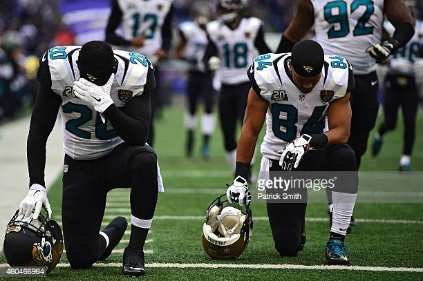 Strong safety Craig Loston of the Jacksonville Jaguars kneels in prayer before a game against the Baltimore Ravens at MT Bank Stadium on December 14...
