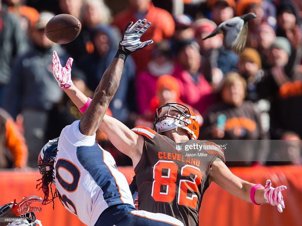 Strong safety David Bruton #30 of the Denver Broncos and tight end Gary Barnidge #82 of the Cleveland Browns fight for a last second throw into the end zone to end the first half at FirstEnergy Stadium on October 18, 2015 in Cleveland, Ohio.