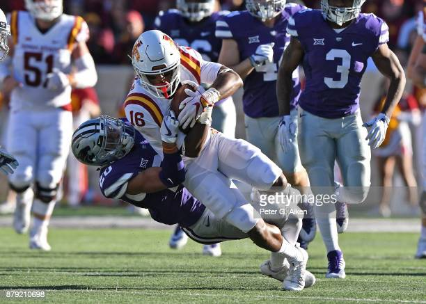 Strong safety Denzel Goolsby of the Kansas State Wildcats tackles wide receiver Marchie Murdock of the Iowa State Cyclones during the first half on...