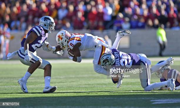 Strong safety Denzel Goolsby of the Kansas State Wildcats tackles wide receiver Deshaunte Jones of the Iowa State Cyclones during the first half on...