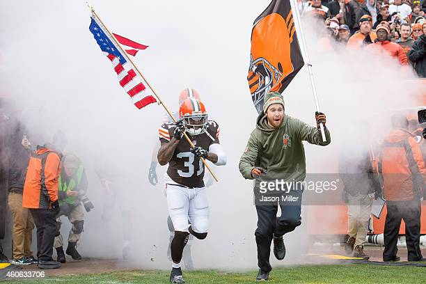 Strong safety Donte Whitner of the Cleveland Browns caries the American flag onto the field during player introductions prior to the game against the...