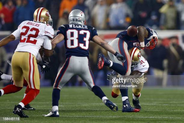 Strong safety Donte Whitner of the San Francisco 49ers forces a fumble on running back Stevan Ridley of the New England Patriots in the third quarter...