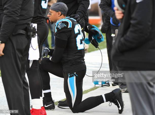 Strong safety Eric Reid of the Carolina Panthers kneels during the National Anthem prior to a game against the Cleveland Browns on December 9 2018 at...