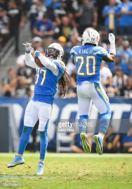 Strong safety Jahleel Addae of the Los Angeles Chargers celebrates a fumble recovery with defensive back Desmond King in the second quarter against...