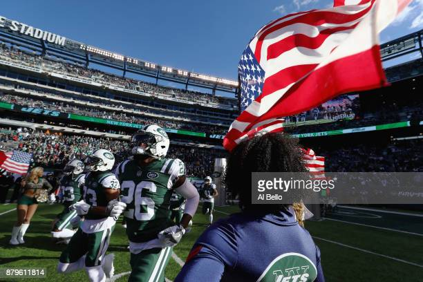 Strong safety Jamal Adams free safety Marcus Maye of the New York Jets and teammates take the field before taking on the Carolina Panthers during the...