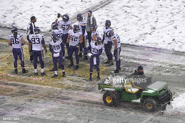 Strong safety Jamarca Sanford of the Minnesota Vikings looks on as the field is cleared of snow against the Baltimore Ravens in the second quarter at...
