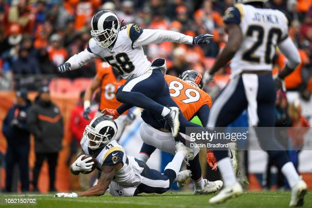 Strong safety John Johnson of the Los Angeles Rams falls to the ground after intercepting a pass intended for tight end Brian Parker of the Denver...