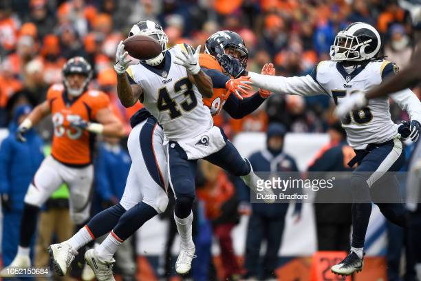 Strong safety John Johnson of the Los Angeles Rams intercepts a pass intended for tight end Brian Parker of the Denver Broncos in the third quarter...