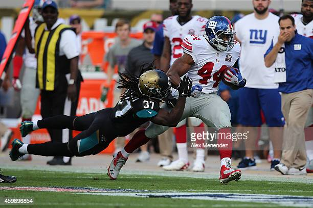Strong safety Johnathan Cyprien of the Jacksonville Jaguars pushes running back Andre Williams of the New York Giants out of bounds during an NFL...