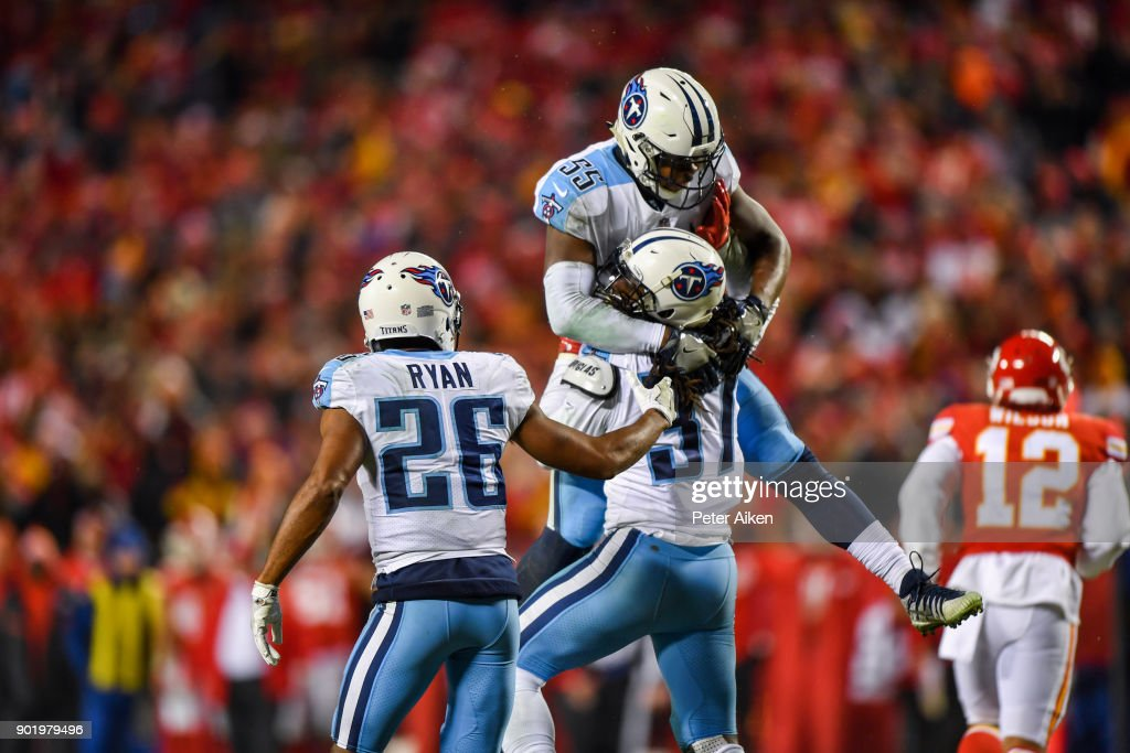 Strong safety Johnathan Cyprien #37 of the Tennessee Titans celebrates with teammate linebacker Jayon Brown #55 after knocking a ball loose on fourth down helping to seal the game against the Kansas City Chiefs during the AFC Wild Card Playoff Game at Arrowhead Stadium on January 6, 2018 in Kansas City, Missouri.