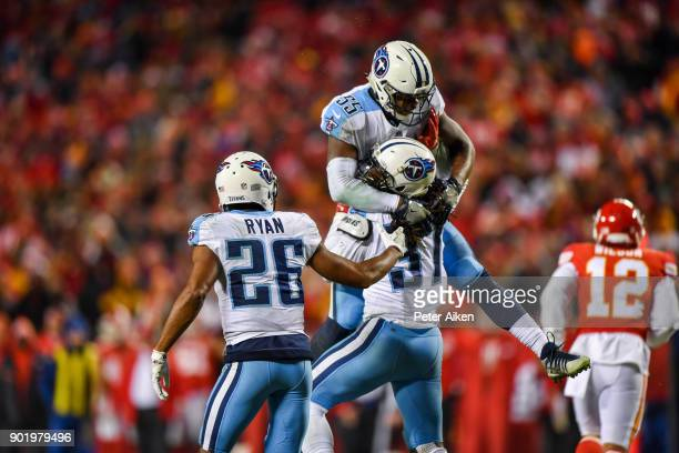 Strong safety Johnathan Cyprien of the Tennessee Titans celebrates with teammate linebacker Jayon Brown after knocking a ball loose on fourth down...