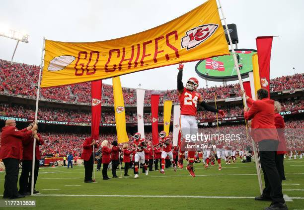 Strong safety Jordan Lucas of the Kansas City Chiefs run onto the field during pregame introductions prior to the game against the Baltimore Ravens...