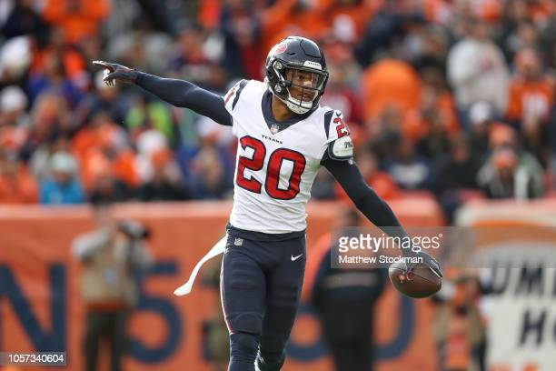 Strong safety Justin Reid of the Houston Texans celebrates after recovering a fumble in the second quarter of a game against the Denver Broncos at...