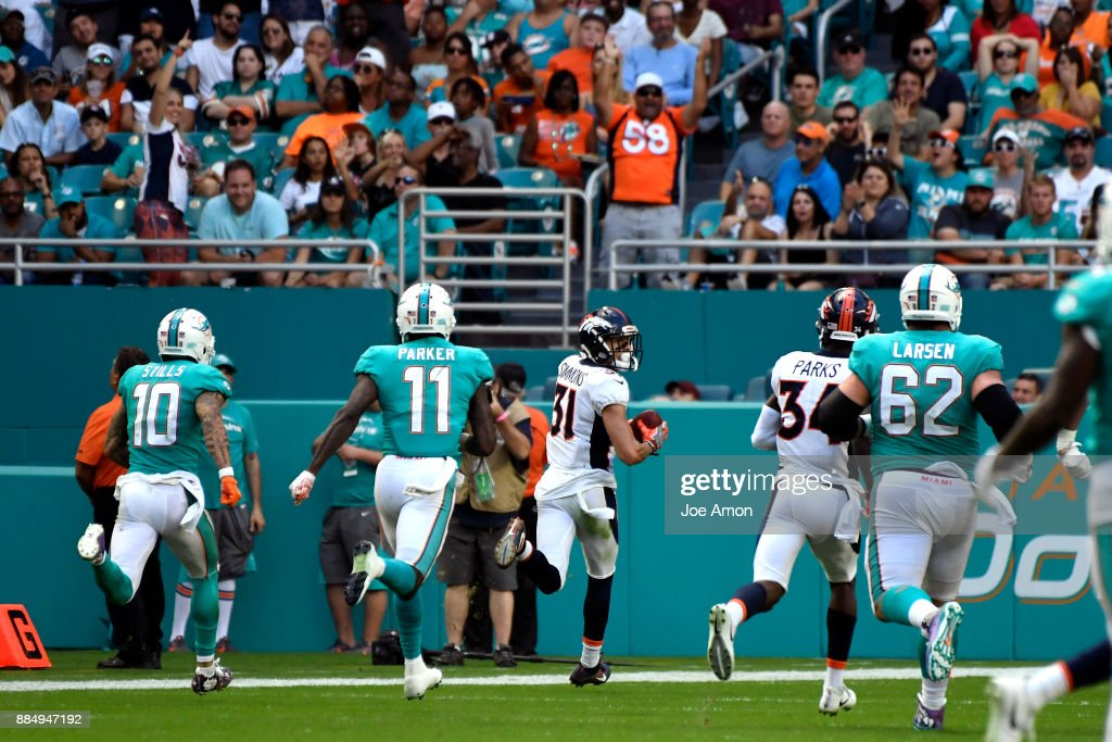 Strong safety Justin Simmons #31 of the Denver Broncos intercepts a ball for a touchdown late in the 3rd quarter to make the score 19-9 the Miami Dolphins at Hard Rock Stadium in Miami Gardens, Florida December 3, 2017.