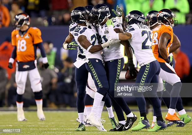 Strong safety Kam Chancellor of the Seattle Seahawks celebrates his interception with teammates against the Denver Broncos in the first quarter...