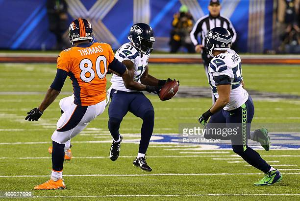 Strong safety Kam Chancellor of the Seattle Seahawks intercepts a pass from quarterback Peyton Manning of the Denver Broncos intended for tight end...