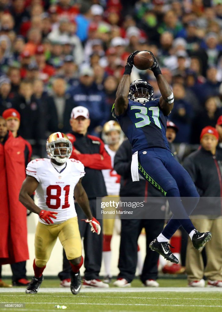 Strong safety Kam Chancellor #31 of the Seattle Seahawks makes an interception in the fourth quarter in front of wide receiver Anquan Boldin #81 of the San Francisco 49ers during the 2014 NFC Championship at CenturyLink Field on January 19, 2014 in Seattle, Washington.