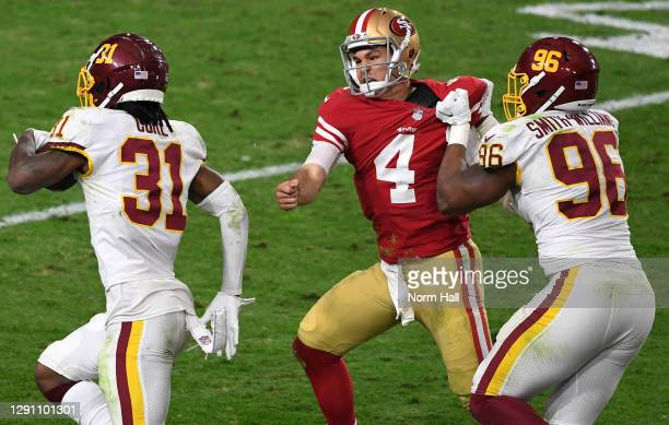 Strong safety Kamren Curl of the Washington Football Team runs for a touchdown on an interception thrown by quarterback Nick Mullens of the San...