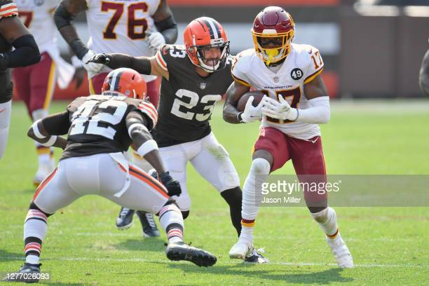 Strong safety Karl Joseph and free safety Andrew Sendejo of the Cleveland Browns pursue wide receiver Terry McLaurin of the Washington Football Team...