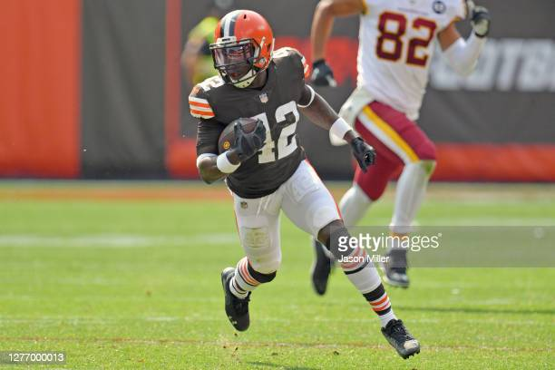 Strong safety Karl Joseph of the Cleveland Browns returns an interception during the second quarter against the Washington Football Team at...