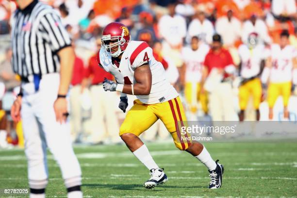 Strong safety Kevin Ellison of the University of Southern California Trojans runs on the field against the University of Virginia Cavaliers on August...