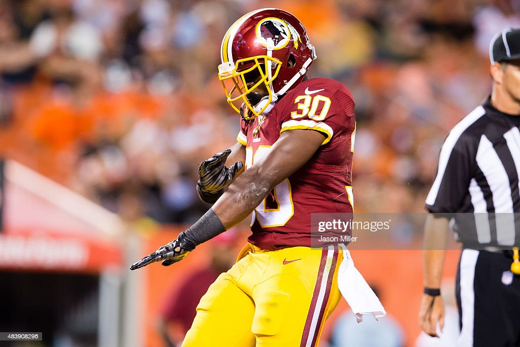 Strong safety Kyshoen Jarrett #30 of the Washington Redskins celebrates after scoring a touchdown during the second half against the Cleveland Browns at FirstEnergy Stadium on August 13, 2015 in Cleveland, Ohio. The Redskins defeated the Browns 20-17.