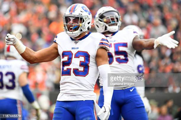 Strong safety Micah Hyde and defensive end Jerry Hughes of the Buffalo Bills gesture toward the crowd in the second quarter of a game against the...
