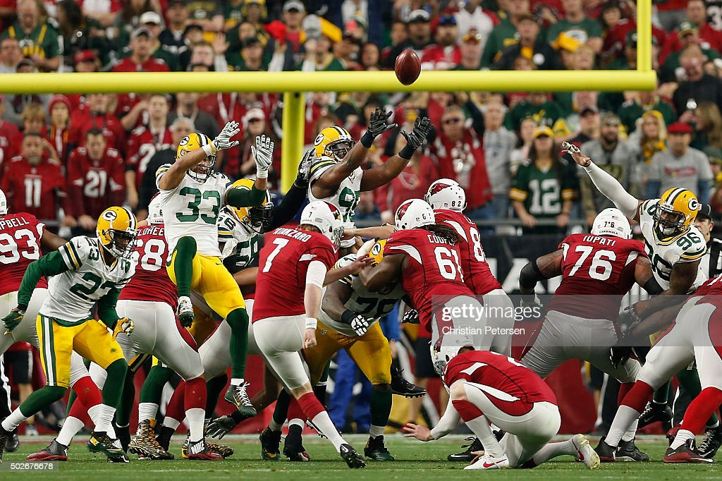 Strong safety Micah Hyde #33, defensive end Datone Jones #95 and outside linebacker Mike Neal #96 of the Green Bay Packers attempt to block an extra point kicked by kicker Chandler Catanzaro #7 of the Arizona Cardinals during the NFL game at the University of Phoenix Stadium on December 27, 2015 in Glendale, Arizona. The Cardinals defeated the Packers 38-8.