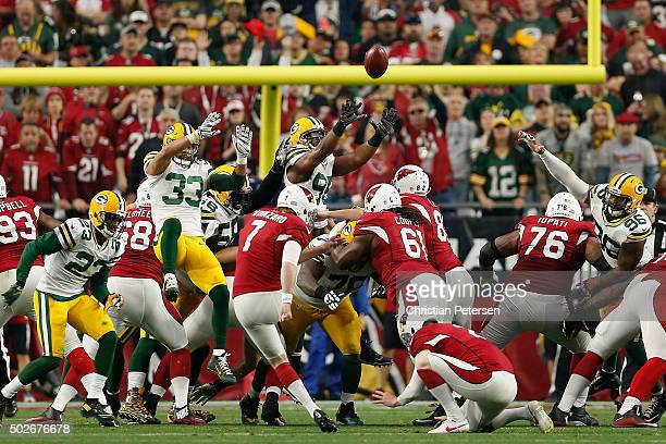 Strong safety Micah Hyde defensive end Datone Jones and outside linebacker Mike Neal of the Green Bay Packers attempt to block an extra point kicked...