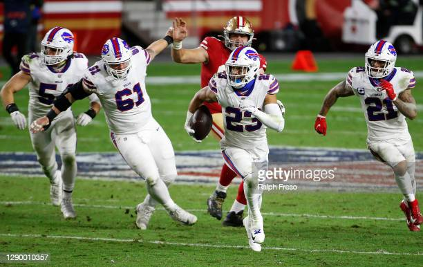 Strong safety Micah Hyde of the Buffalo Bills intercepts a pass ahead of free safety Jordan Poyer and defensive tackle Justin Zimmer during the third...