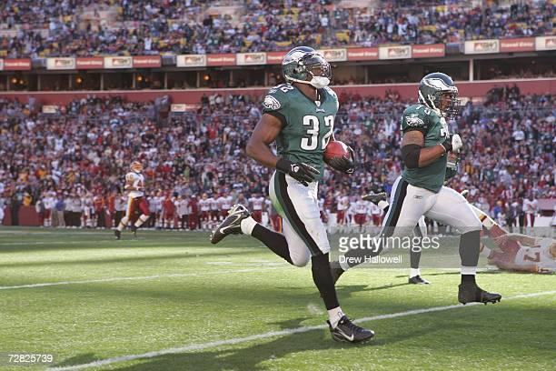 Strong Safety Michael Lewis of the Philadelphia Eagles runs for a touchdown after an interception during the game against the Washington Redskins on...
