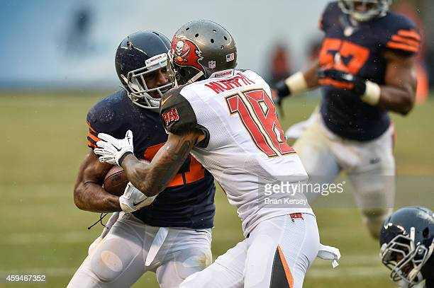 Strong safety Ryan Mundy of the Chicago Bears carries the interception against wide receiver Louis Murphy of the Tampa Bay Buccaneers in the third...