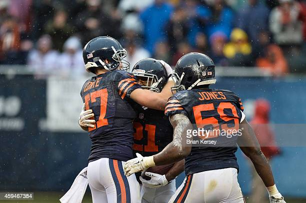 Strong safety Ryan Mundy of the Chicago Bears celebrates with Chris Conte and Christian Jones after intercepting the football against the Tampa Bay...