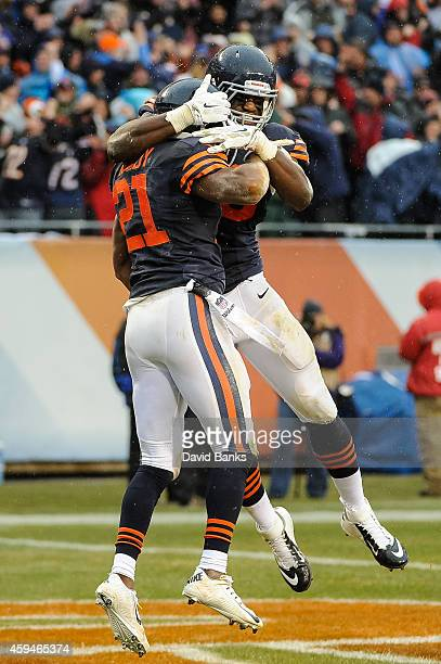 Strong safety Ryan Mundy of the Chicago Bears celebrates with inside linebacker Christian Jones after intercepting the football intended for running...