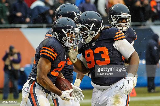 Strong safety Ryan Mundy of the Chicago Bears celebrates with defensive tackle Will Sutton after intercepting the football intended for running back...
