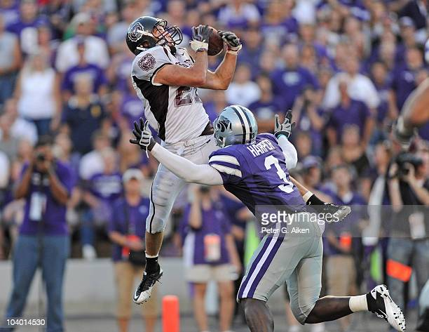 Strong safety Skylar Smith of the Missouri State Bears brakes up a pass intended for wide receiver Chris Harper of the Kansas State Wildcats in the...