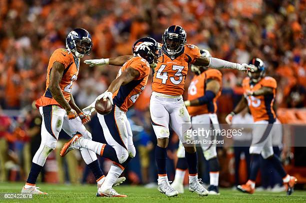 Strong safety TJ Ward and cornerback Aqib Talib of the Denver Broncos celebrate after a fourth quarter interception by cornerback Chris Harris of the...