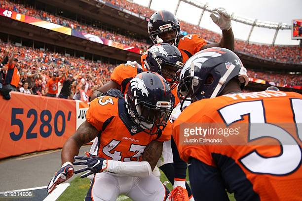 Strong safety TJ Ward of the Denver Broncos celebrates after intercepting the ball in the third quarter of the game against the San Diego Chargers at...