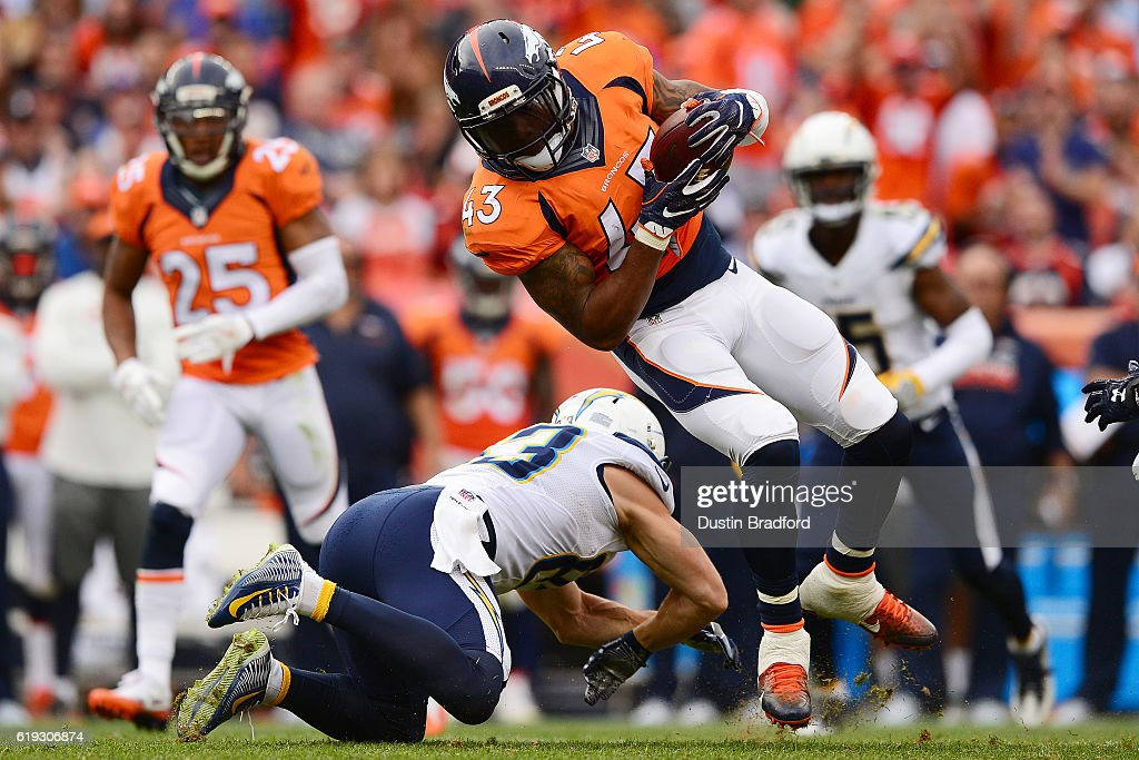 Strong safety T.J. Ward #43 of the Denver Broncos intercepts the ball in the third quarter of the game against the San Diego Chargers at Sports Authority Field at Mile High on October 30, 2016 in Denver, Colorado.
