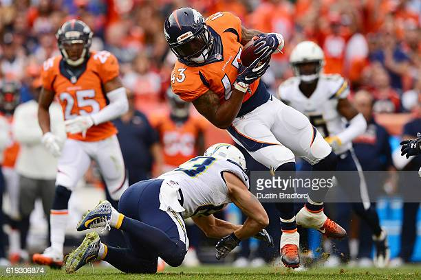 Strong safety TJ Ward of the Denver Broncos intercepts the ball in the third quarter of the game against the San Diego Chargers at Sports Authority...