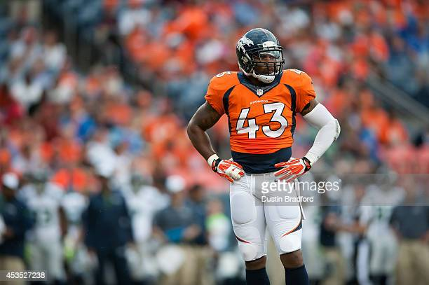 Strong safety TJ Ward of the Denver Broncos stands on the field during a pause in the game against the Seattle Seahawks during preseason action at...