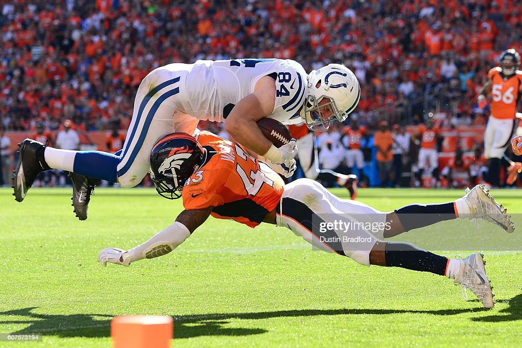 Strong safety T.J. Ward #43 of the Denver Broncos tackles tight end Jack Doyle #84 of the Indianapolis Colts in the red zone in the third quarter of the game at Sports Authority Field at Mile High on September 18, 2016 in Denver, Colorado.
