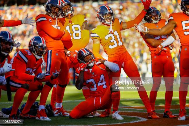 Strong safety Will Parks of the Denver Broncos celebrates with teammates after forcing a fumble and preventing a second quarter touchdown against the...