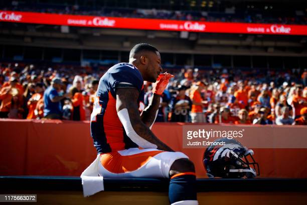 Strong safety Will Parks of the Denver Broncos sniffs smelling salts on the bench before a game against the Tennessee Titans at Empower Field at Mile...