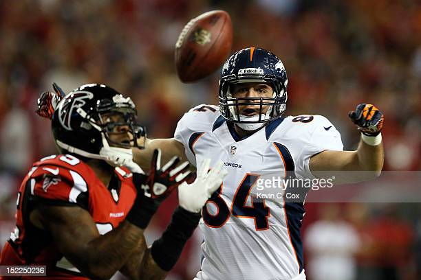 Strong safety William Moore of the Atlanta Falcons intercepts a pass intended for tight end Jacob Tamme of the Denver Broncos during a game at the...
