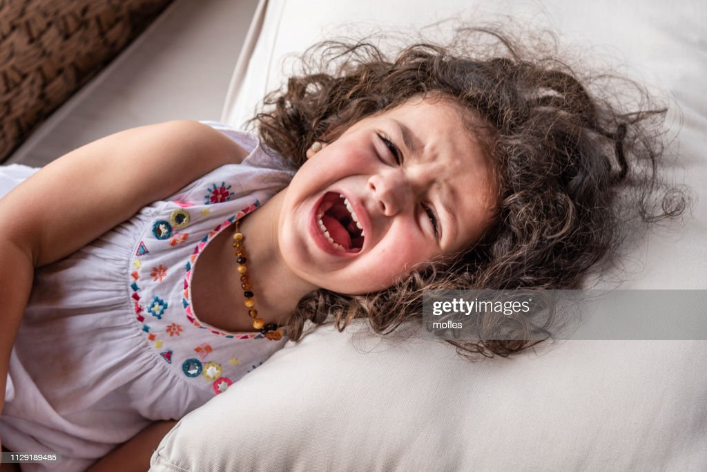Strong screaming due to a tantrum : Stock Photo